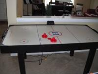 This is a nice air hockey table that plugs in and has