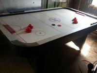 Harvard Air Hockey Table. Been stored in yard bar.