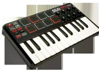 Akai MPK Mini brand new. Hooked up to computer once.