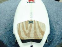 5'7 Al Merrick in great condition. It does have a small