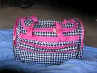 Houndstooth Travel Bag with pink trim and lining. It