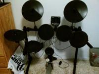 Fairly new alesis dm 6 electronic drum set with very