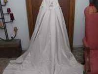 Cafe colored brand new never been worn wedding dress.