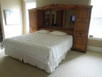 Medium Oak master bedroom set includes mirrored bridge