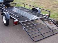 This is a 2012 model 5X8 utility trailer with a loading