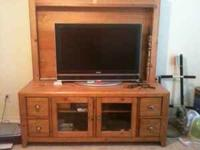 All wood entertainment center, no particle board, in