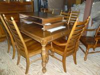 Solid wood table includes 2 large leaves, 8 chairs,