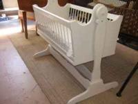 This is a cute vintage all wood shabby white cradle in