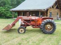 Very nice Tractor with trip bucket, new battery, new