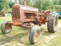 For sale: Allis Chalmers D19 gas, double weights on