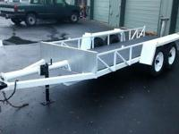 "All ALLUMINUM trailer. Deck is 51"" x 14', trailer has"