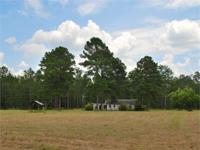 Quality tract with an older home located on Lucy Moore