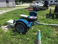 Almost new tow dolly complete with electric brake