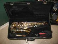 This is a Leblanc Vito Alto Saxophone. The instrument