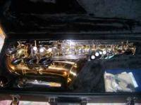 SAXOPHONE ((( CONN ))) WITH a HARD CASE AND NECK STRAP