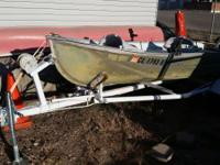 14 foot alum boat and trailer, swivel seats, oars, 2