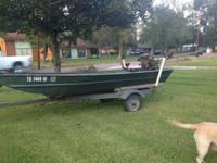 title to boat and galvanized trailer. with a 16 hp go
