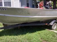 1974 14 ft silver boat/trailer and yamaha 8hp, electric