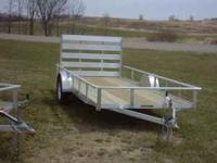 """NEW...76"""" X 14' Aluminum trailer...it has a 3500 lb"""