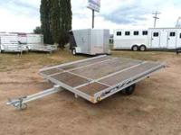 This is a like new aluminum snowmobile trailer. It is