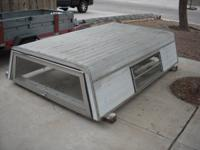 Selling aluminum camper shell for a full size truck