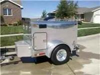 Small polished aluminum trailer. Has 4 kennels, 2 side