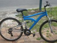 Mountain bicycle with shocks all over, and built for