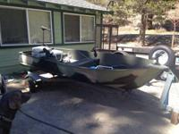 10 ft aluminum boat with trailer and brand-new Suzuki