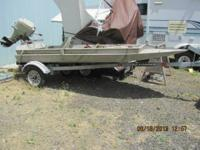 THIS IS A NEAT ALUMNIUM DUCK HUNTER'S BOAT WITH TRAILER