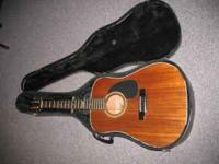 Alvanez Guitar for sale, with black case and music