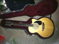 I have a very nice Alvarez 12 String Jumbo body guitar.