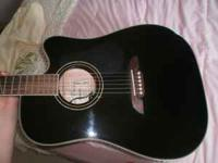 Alvarez acoustic electric guitar. Model #: ad60sc.