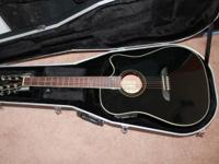 Black Alvarez acoustic guitar with case for $200. I