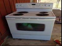 Amana electrical stove and overhead microwave. Range is