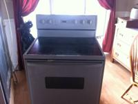 Great working amana electric flat top stove for sale.