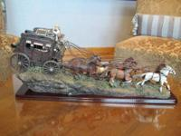 Western action captured in this detailed stage coach