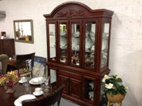 REMARKABLE CHINA CABINET. $500. This china cabinet is