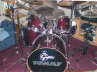 "OLDER SET OF BLACK DAITO DRUMS AND ""BRAND NEW"" SET OF"