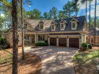 1051 Swift Creek is a beautiful golf homernlocated on