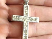 I have an amazing solid gold and diamond cross! It