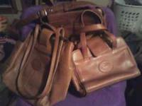 I have 2 America Angle handbags and 1 purse for sale.