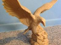 Hand carved American eagle from cow bone. It is made in