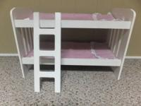 Selling a white bunk bed with bed linen and ladder that