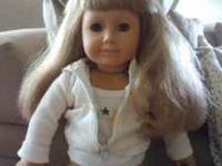 "I am selling a used American Girl Doll, she is a ""just"