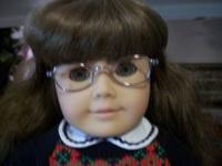 This is a american girl doll Molly with glasses and