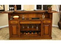 A beautiful raised panel home bar! Carefully