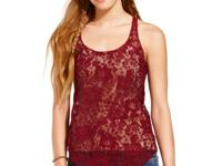 Racerback design gives this dainty lace tank top a