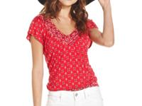 A printed, short sleeve blouson top is designed with a