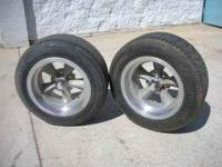 Two 16X9 wheels with tires Chevy bolt patter good