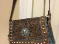 American West engraved leather bag with 2 slip pockets